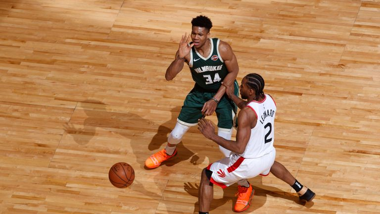 Giannis Antetokounmpo throws a pass beyond the reach of Kawhi Leonard in Game 4 of the Eastern Conference Finals