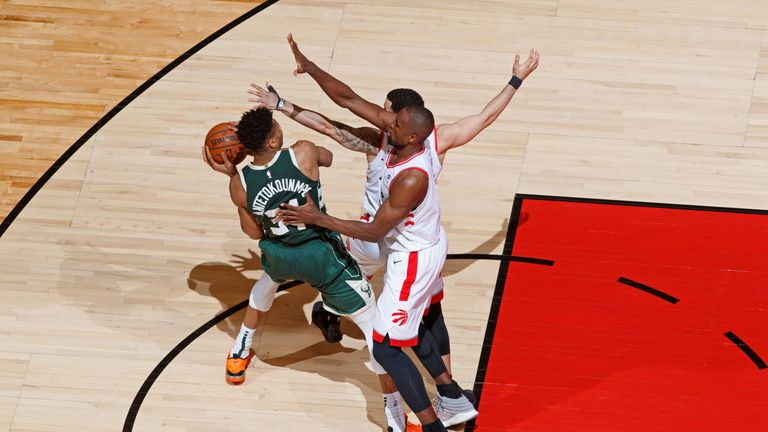 Giannis Antetokounmpo is walled off in the paint in Game 4