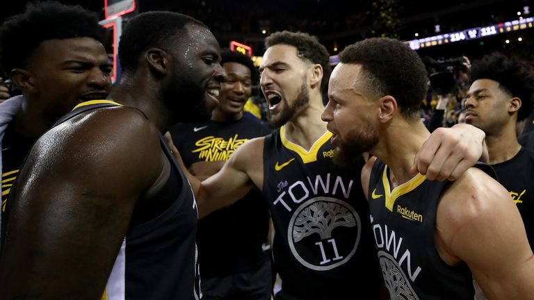 Draymond Green, Klay Thompson and Stephen Curry celebrate Golden State's Gane 2 win over the Portland Trail Blazers