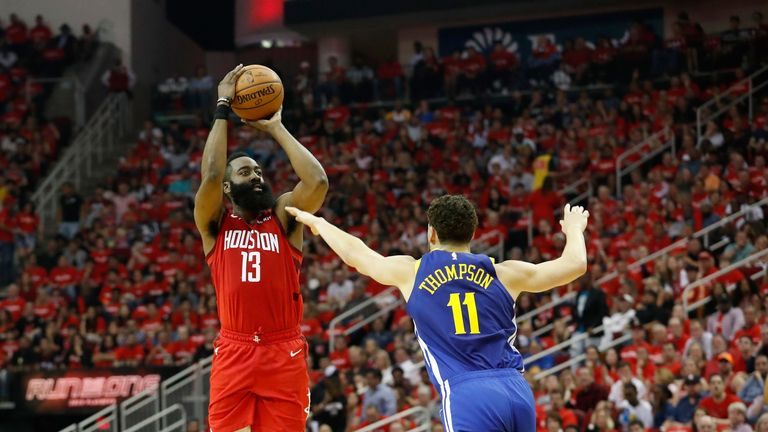 James Harden is fouled by Klay Thompson before making a thee-point shot