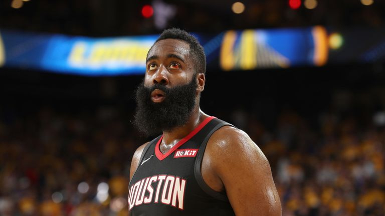 James Harden watches a replay during the Rockets' Game 5 loss to Golden State