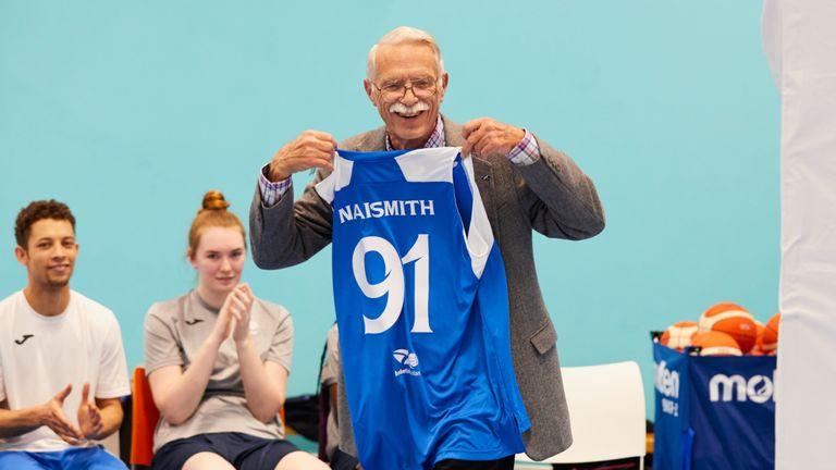 Jim Naismith holds his Scotland Basketball jersey - photo courtesy of Simon Way/NBAE