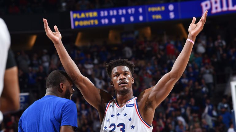 Jimmy Butler salutes the fans in Philadelphia after leading the 76ers to a Game 6 win over the Toronto Raptors