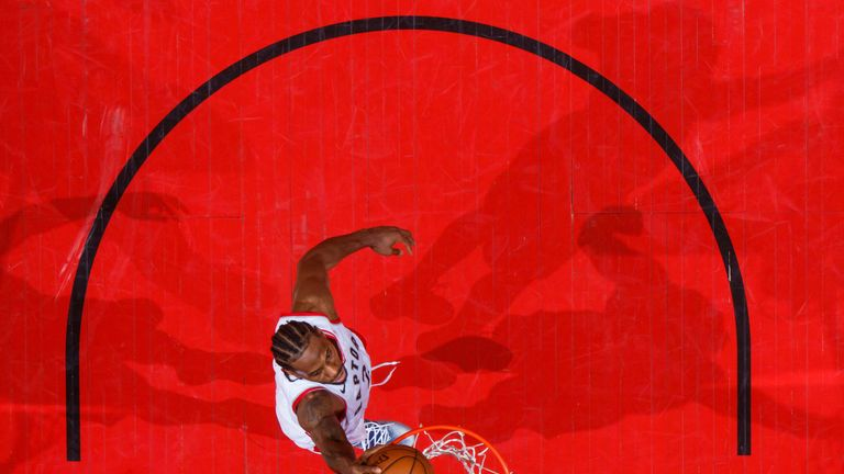 Kawhi Leonard scores with a dunk in the Raptors' Game 3 win over the Bucks