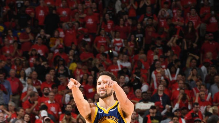 Klay Thompson celebrates after hitting a series-clinching three-pointer in Game 6 against the Houston Rockets