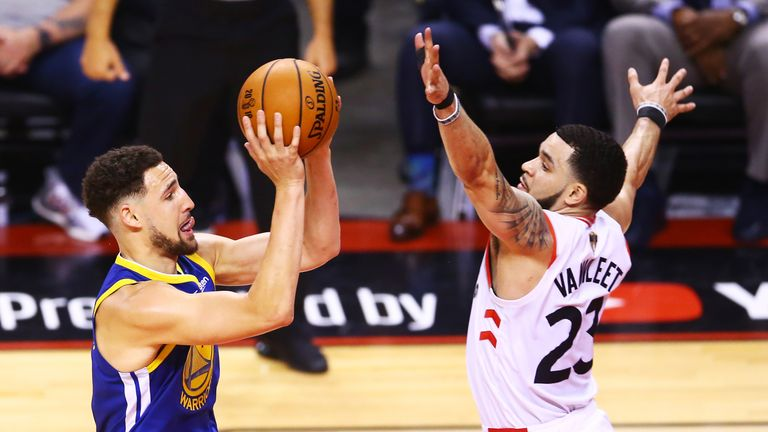 Klay Thompson has Fred VanVleet's hand right in his face as he tries to shoot