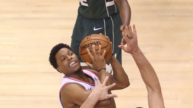 Kyle Lowry shoots over Brook Lopez in Game of the Eastern Conference Finals