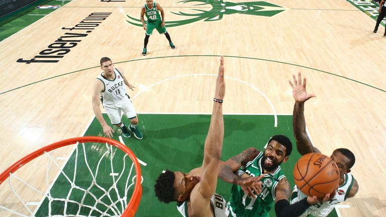 Kyrie Irving shoots the ball during Game 2 of the Boston Celtics' series with Milwaukee Bucks