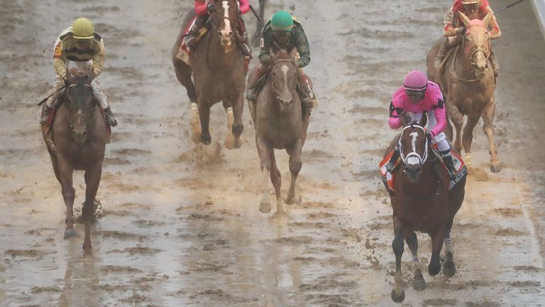 Maximum Security passes the post first in the Kentucky Derby