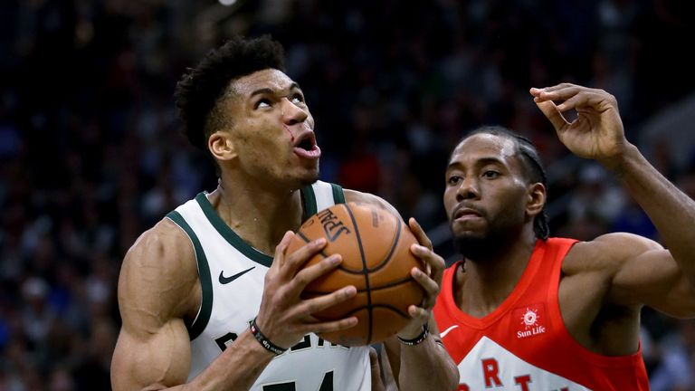 Giannis Antetokounmpo struggles to escape the close attentions of Kawhi Leonard