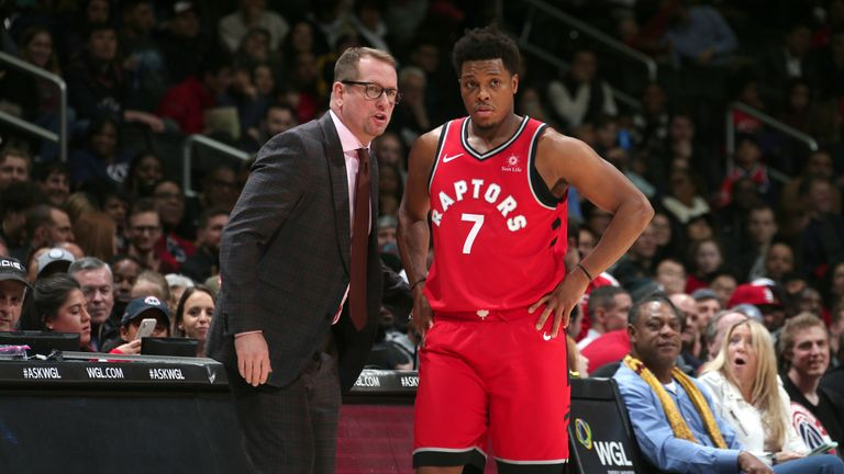 Nurse talks to Raptors guard Kyle Lowry