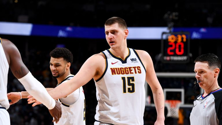 Nikola Jokic offers encouragement to his Nuggets team-mates in Game 2 against Portland