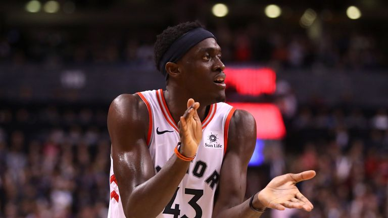 Pascal Siakam applauds his team-mates during the Raptors' Game 1 win over the Golden State Warriors