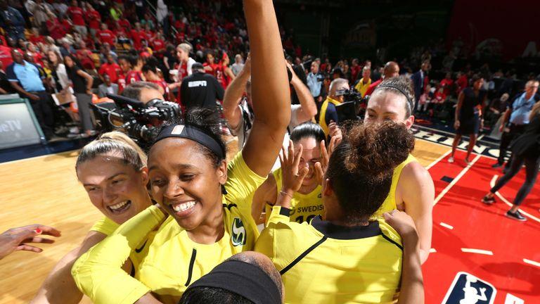 Seattle Storm players celebrate winning the 2018 WNBA title
