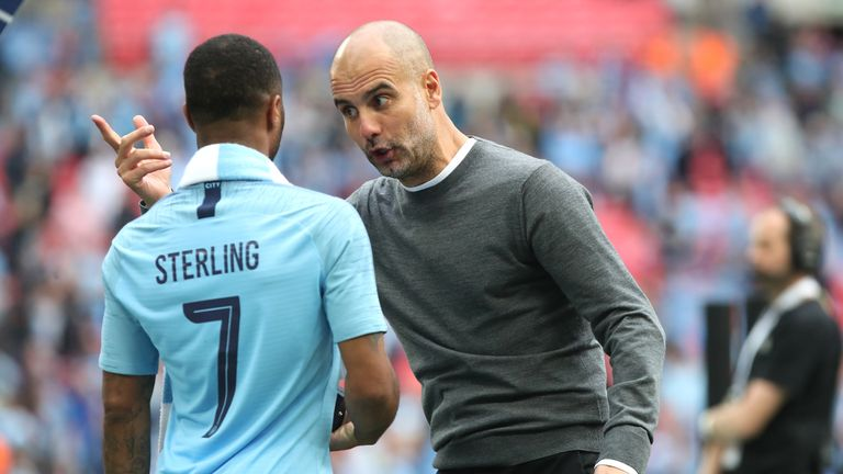 Manchester City's Raheem Sterling (left) and manager Pep Guardiola