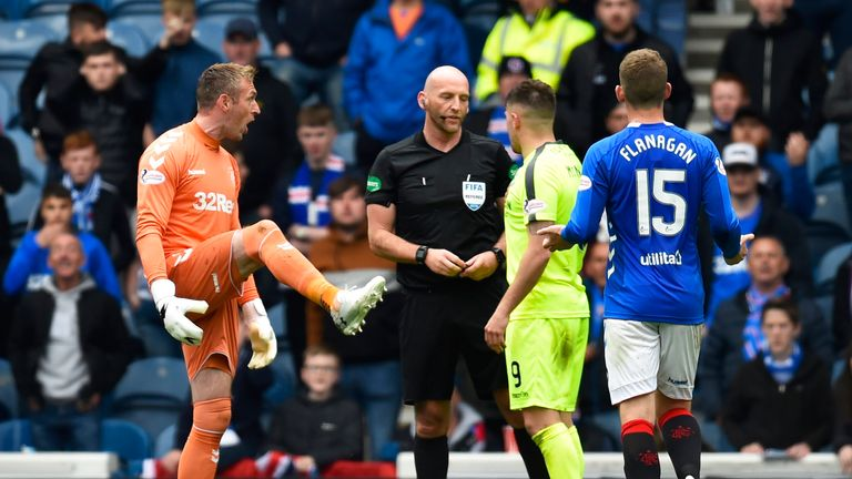Allan McGregor is sent off for kicking out at Marc McNulty during the game at Ibrox