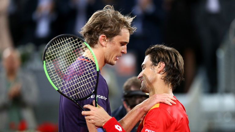 Zverev embraces Ferrer after the Spaniard played his last-ever match at the Mutua Madrid Open last year