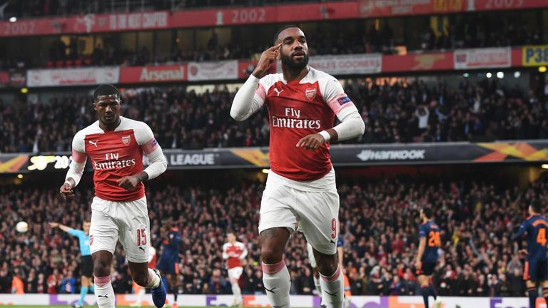 Alexandre Lacazette scored twice in Arsenal's first leg win over Valencia