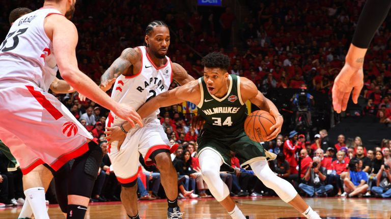 Giannis Antetokounmpo of the Milwaukee Bucks handles the ball against Kawhi Leonard of the Toronto Raptors during Game Three of the Eastern Conference Finals