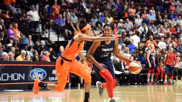 Ariel Atkins of the Washington Mystics handles the ball against the Connecticut Sun
