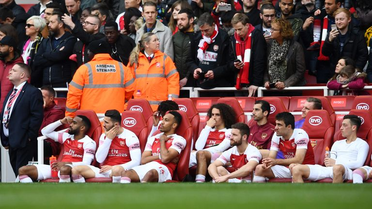 Arsenal players look dejected following a draw in the Premier League match between Arsenal FC and Brighton & Hove Albion at Emirates Stadium on May 05, 2019 in London, United Kingdom.