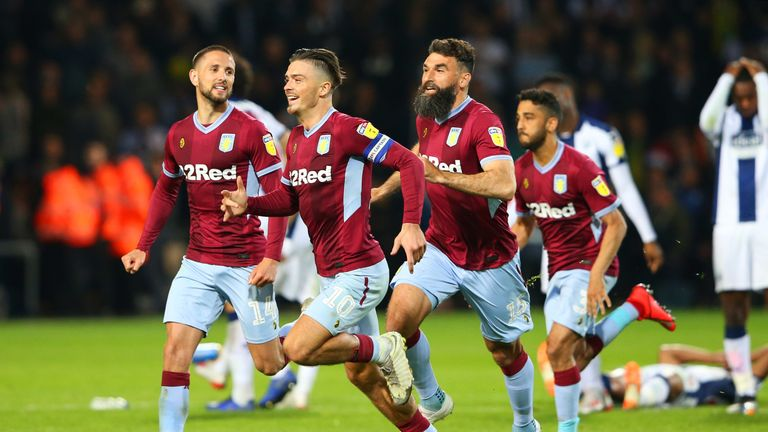 Aston Villa celebrate winning the Championship play-off semi-final against West Brom on penalties