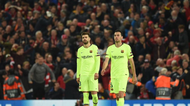 Gerard Pique and Sergio Busquets look dejected after the fourth goal