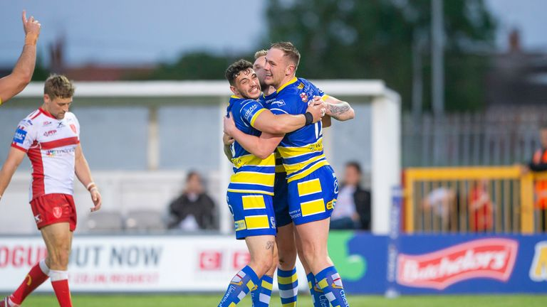 Warrington's Ben Currie is congratulated on his try against Hull KR