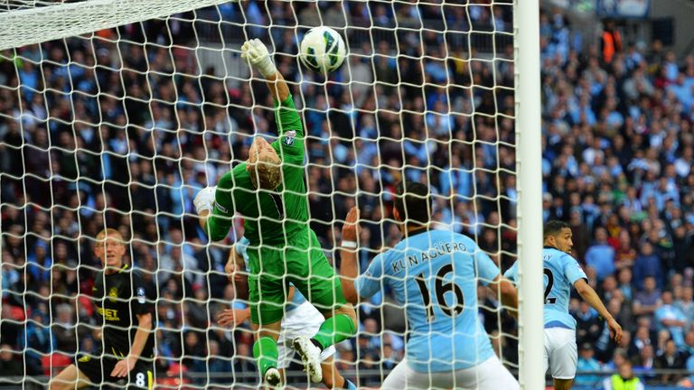 Ben Watson's header secured a memorable win for Wigan over Manchester City