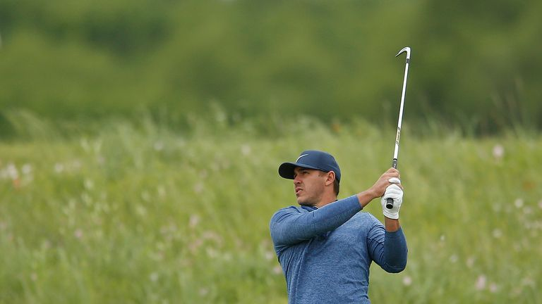 Brooks Koepka made four late birdies to get back in contention