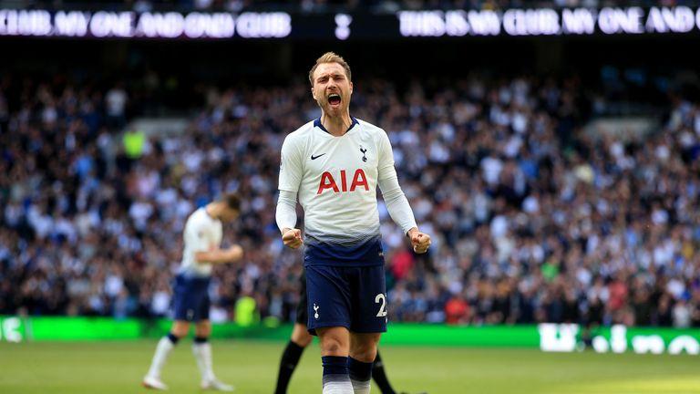 Christian Eriksen celebrates his brilliant free-kick against Everton