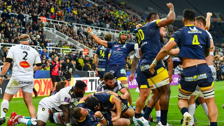 Clermont players celebrate after their pivotal second try via Fritz Lee at the back of a maul