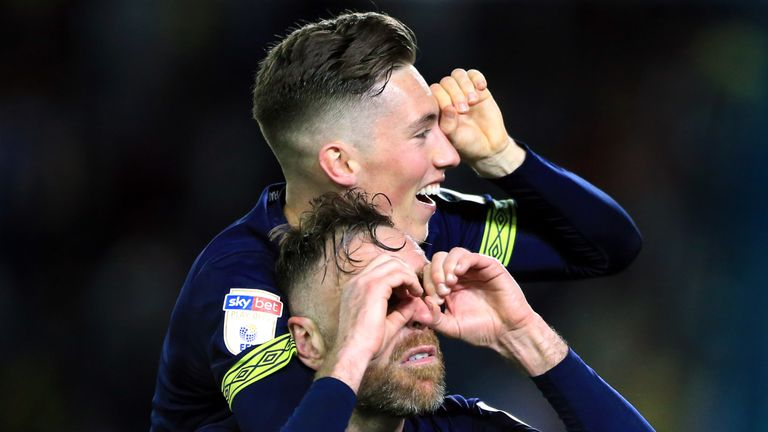 Derby County's Richard Keogh and Harry Wilson (top) make binocular gestures in reference to 'spygate'