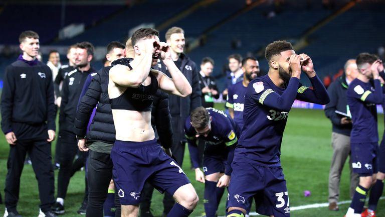 Derby County's Tom Lawrence (left) and Jayden Bogle make binocular gestures