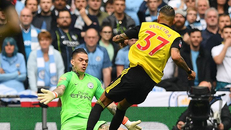 Ederson denies Watford's Roberto Pereyra during the first half of the FA Cup final