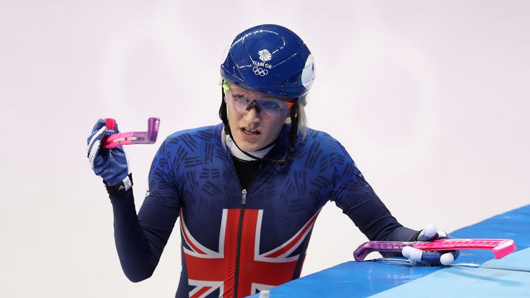 Great Britain's Elise Christie prepares to leave the ice after being disqualified.