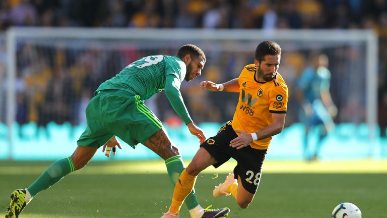 Etienne Capoue and Joao Moutinho during the Premier League match between Wolverhampton Wanderers and Watford FC at Molineux on October 20, 2018 in Wolverhampton, United Kingdom.