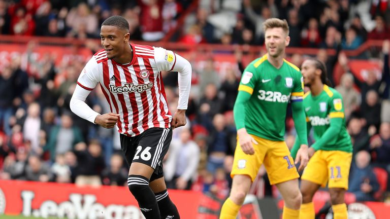 Ezri Konsa turns to celebrate after scoring against Brentford