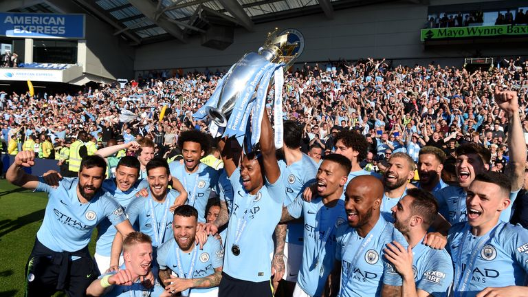 Fernandinho celebrates with the Premier League trophy after Man City win the title