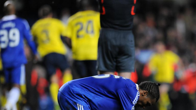 Chelsea winger Florent Malouda falls to his knees at the full-time whistle