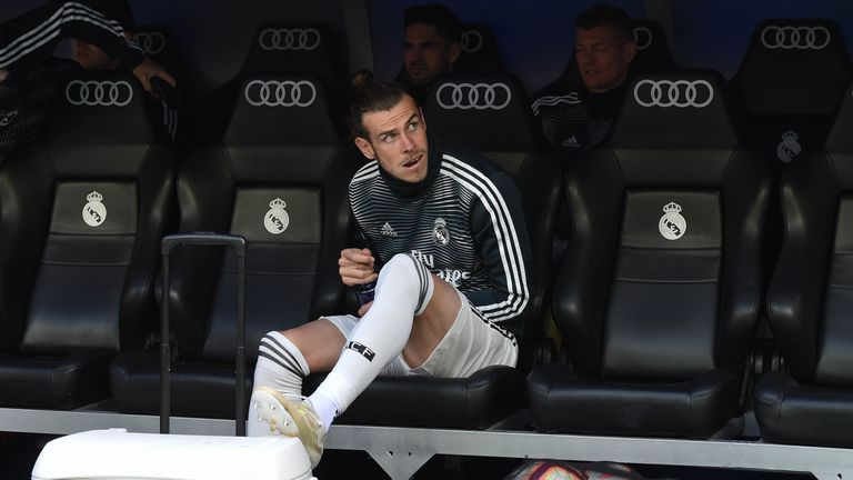 Bale looks on from the Real Madrid bench