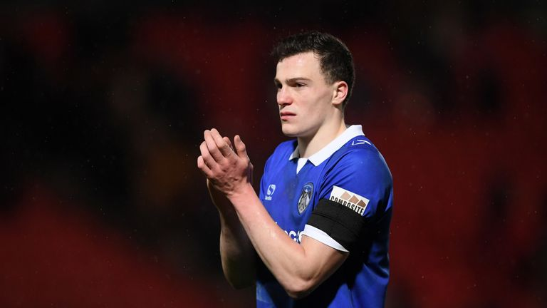 Oldham's George Edmundson has been linked with a move to Scottish side Rangers.