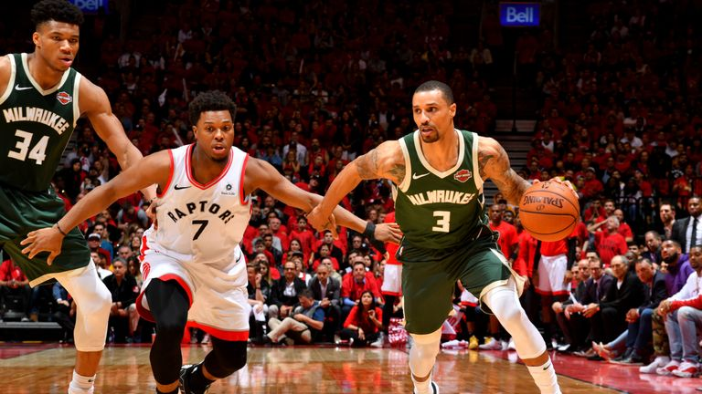 George Hill #3 of the Milwaukee Bucks handles the ball against Kyle Lowry #7 of the Toronto Raptors during Game Three of the Eastern Conference Finals of the 2019 NBA Playoffs on May 19, 2019 at the Scotiabank Arena in Toronto, Ontario, Canada.