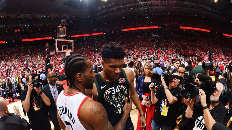Kawhi Leonard of the Toronto Raptors and Giannis Antetokounmpo of the Milwaukee Bucks hug after Game Six of the Eastern Conference Finals