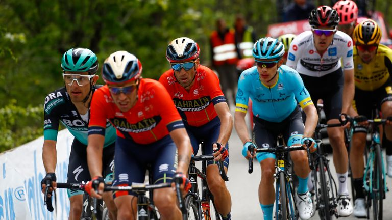 Italy's Vincenzo Nibali (C) and Colombia's Miguel Angel Lopez (4thL) compete in stage 14 of the 102nd Giro d'Italia