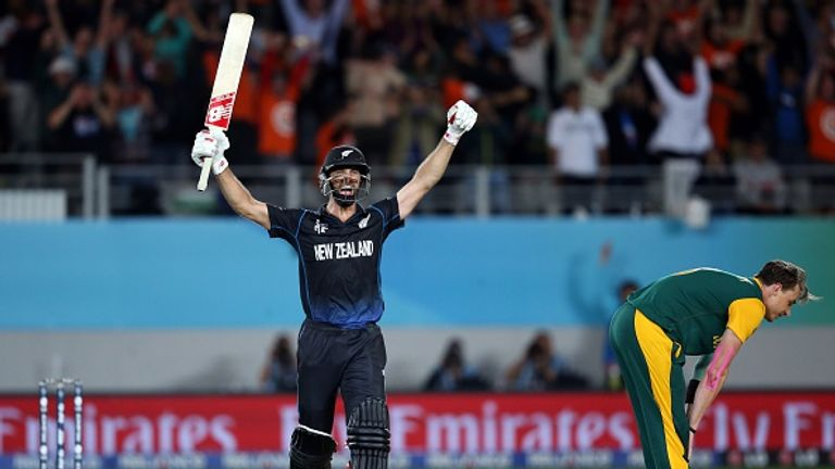 New Zealand's Grant Elliott celebrates his match-clinching six off South Africa's Dale Steyn