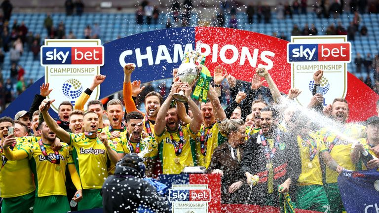Captain Grant Hanley lifts the Sky Bet EFL Championship trophy as Norwich City are crowned champions