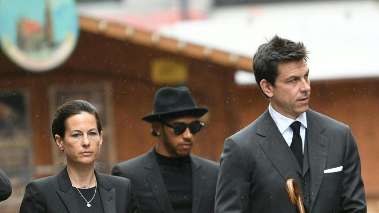 Hamilton (C) and Mercedes boss Toto Wolff (R) arrive for Lauda's funeral