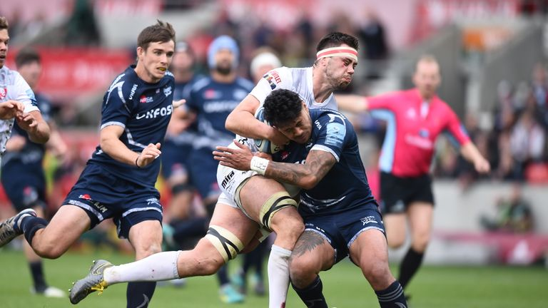 Gloucester's Jake Polledti of Gloucester is tackled by Sale's Denny Solomona