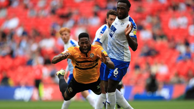 """Newport County's Jamille Matt (left) reacts to a challenge from Tranmere Rovers' Emmanuel Monthe, leading to a penalty appeal during the Sky Bet League Two Play-off final at Wembley Stadium, London. PRESS ASSOCIATION Photo. Picture date: Saturday May 25, 2019. See PA story SOCCER League Two. Photo credit should read: Mike Egerton/PA Wire. RESTRICTIONS: EDITORIAL USE ONLY No use with unauthorised audio, video, data, fixture lists, club/league logos or """"live"""" services. Online in-match use limited to 120 images, no video emulation. No use in betting, games or single club/league/player publications"""